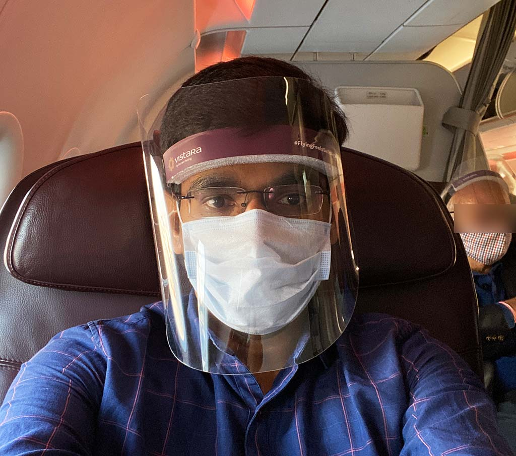 On Vistara Business Class seat with covid mask and shield